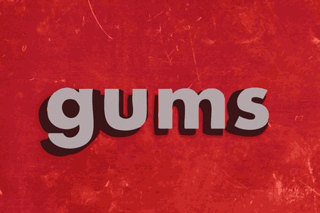 gums: gums word on red concrete wall