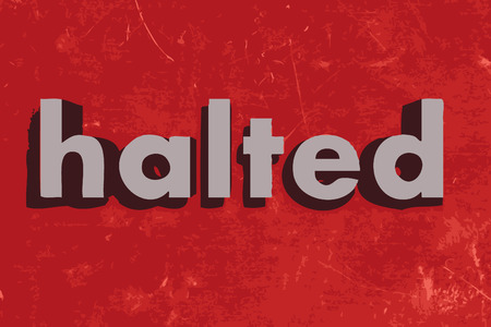 halted: halted word on red concrete wall Illustration