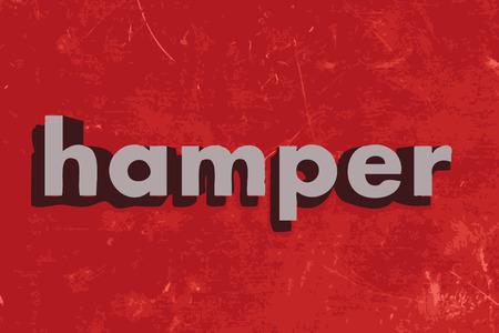 hamper: hamper word on red concrete wall
