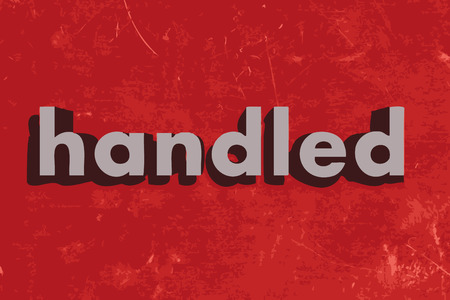 handled: handled word on red concrete wall