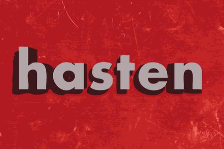 to hasten: hasten word on red concrete wall
