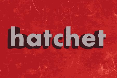 hatchet: hatchet word on red concrete wall