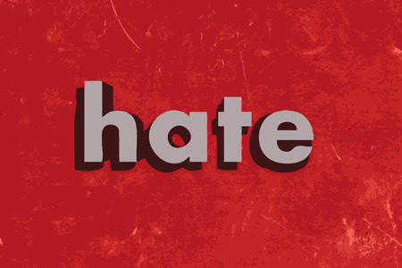 hate: hate word on red concrete wall