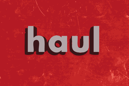 haul: haul word on red concrete wall