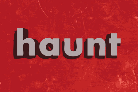 haunt: haunt word on red concrete wall