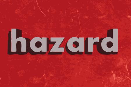 hazard: hazard word on red concrete wall