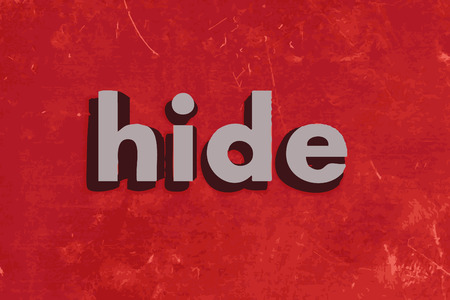 hide: hide word on red concrete wall