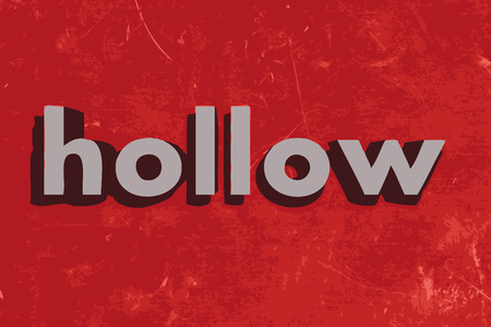 hollow walls: hollow word on red concrete wall