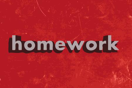 homework: homework word on red concrete wall