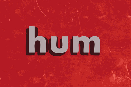 hum: hum word on red concrete wall