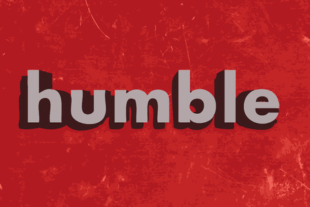 humble: humble word on red concrete wall