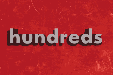 hundreds: hundreds word on red concrete wall