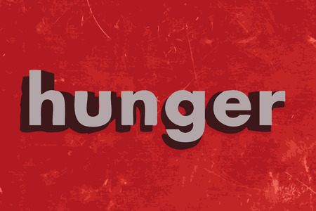 hunger: hunger word on red concrete wall