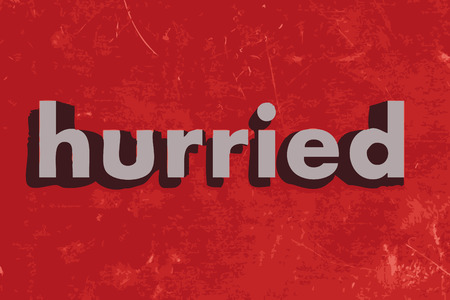hurried: hurried word on red concrete wall