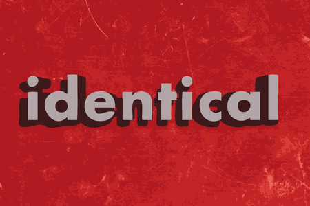 identical: identical word on red concrete wall