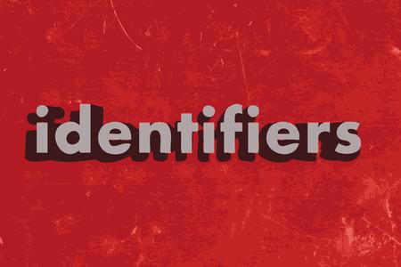 identifiers: identifiers word on red concrete wall