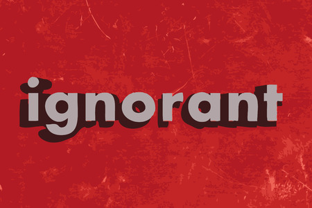 ignorant: ignorant word on red concrete wall