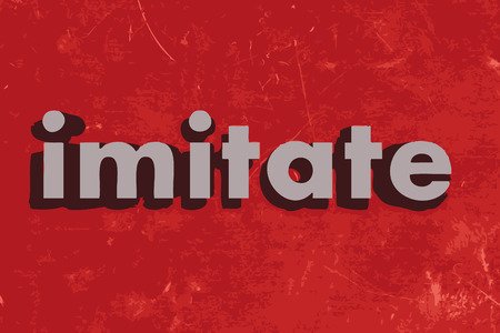 imitate: imitate word on red concrete wall
