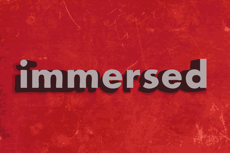 immersed: immersed vector word on red concrete wall