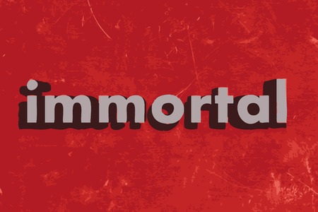 immortal: immortal word on red concrete wall