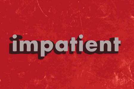 impatient: impatient word on red concrete wall