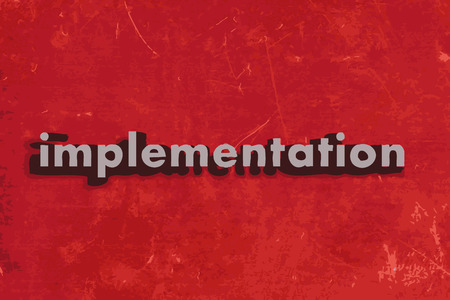 implementation: implementation word on red concrete wall