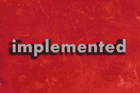 implemented: implemented word on red concrete wall