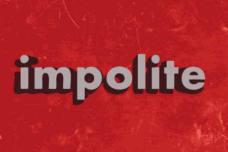 impolite: impolite word on red concrete wall