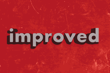 improved: improved word on red concrete wall