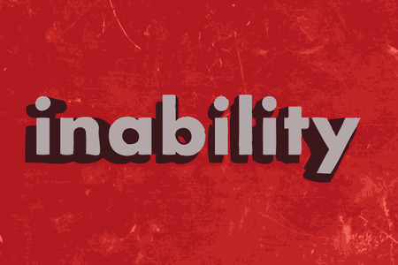 inability: inability word on red concrete wall