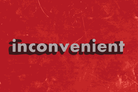 inconvenient: inconvenient word on red concrete wall Illustration