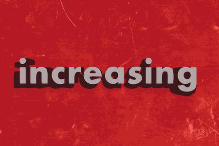 increasing: increasing word on red concrete wall