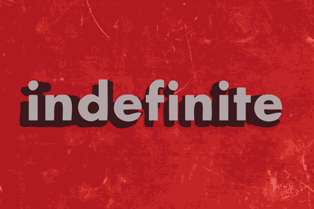 indefinite: indefinite word on red concrete wall