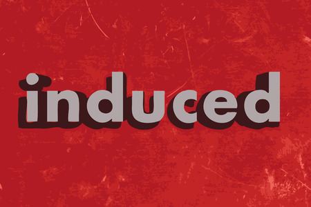induced: induced word on red concrete wall Illustration