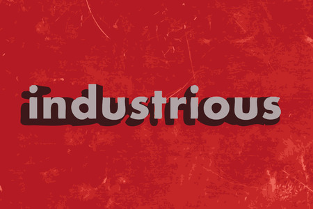 industrious: industrious word on red concrete wall