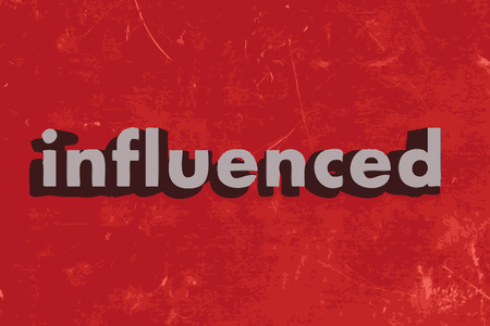 influenced: influenced word on red concrete wall
