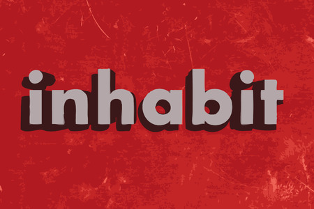 inhabit word on red concrete wall