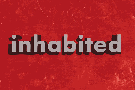 inhabited: inhabited word on red concrete wall