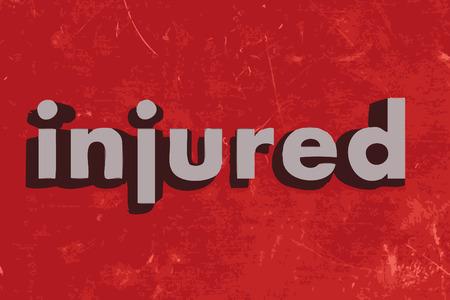 injured: injured word on red concrete wall