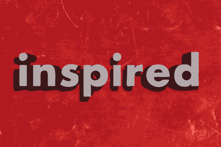 inspired word on red concrete wall