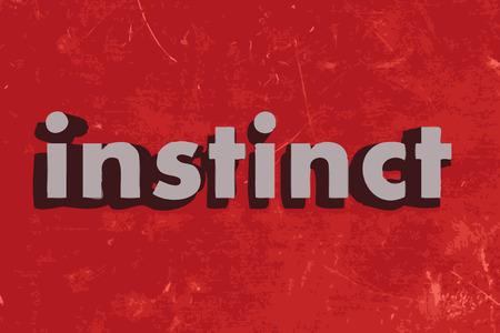 instinct: instinct word on red concrete wall