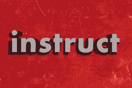 instruct: instruct word on red concrete wall