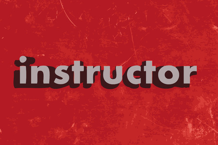 the instructor: instructor word on red concrete wall