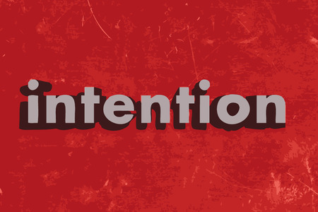 intention: intention word on red concrete wall
