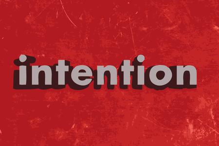 palabra intención en rojo muro de hormigón