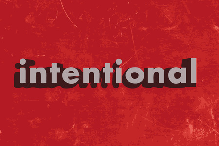 intentional: intentional word on red concrete wall