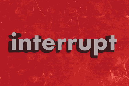 interrupt: interrupt word on red concrete wall