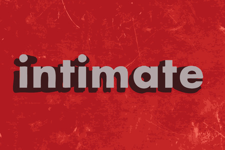 intimate: intimate word on red concrete wall