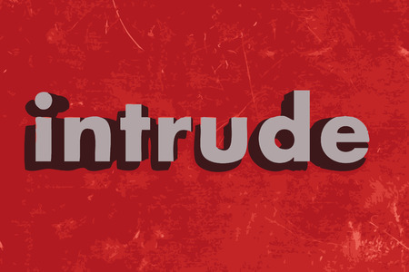 intrude: intrude word on red concrete wall