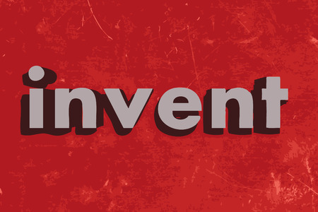 invent: invent word on red concrete wall